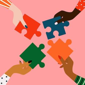 Vrouwenhanden van verschillende nationaliteitenhet concept van vrouwelijke vriendschapsgelijkheid en partnerschap