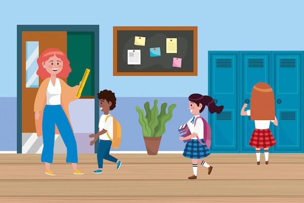 Vrouwenleraar met jongens en meisjesstudenten met kasten
