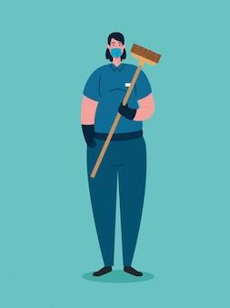 Vrouwenreiniger die medisch masker gebruiken tijdens covid 19 pandemie