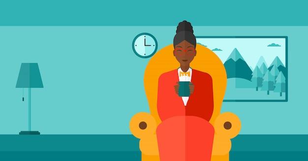 Vrouwenzitting als voorzitter met kop thee