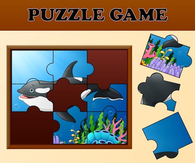 Walvis in onderzeese met puzzel concept
