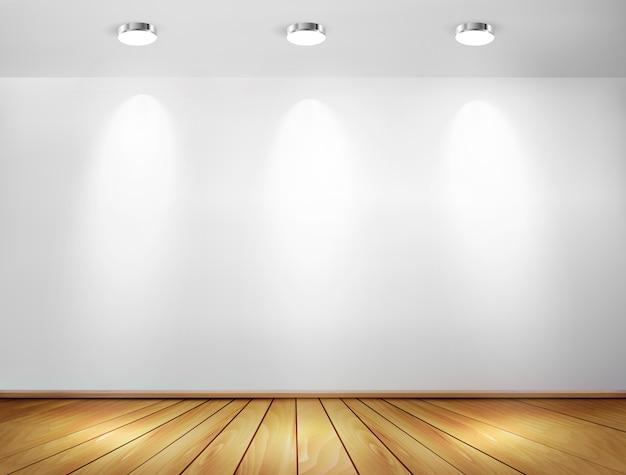 Wand met schijnwerpers en houten vloer