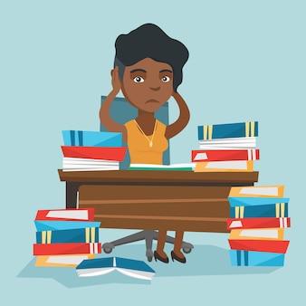 Wanhopige student studeert met veel schoolboeken.
