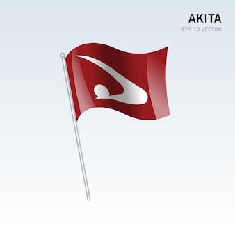 Wapperende vlag van de prefecturen akita van japan geïsoleerd op een grijze background