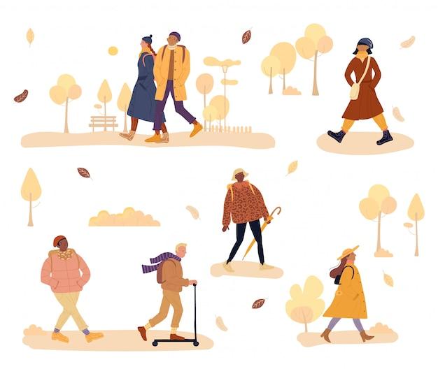 Warm geklede mensen lopen, gaan koude herfst werken