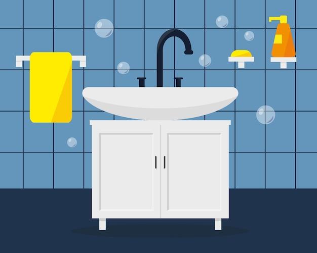 Wastafel met zeep en handdoek in badkamer.