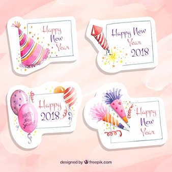 Waterverf roze badges van een nieuwjaar feest