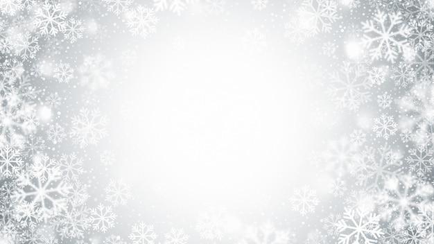 Wazige beweging vliegende sneeuwvlokken abstracte kerstdecoratie op lichte zilveren achtergrond