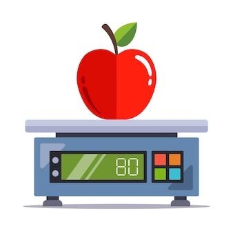 Weeg een appel op een elektronische weegschaal in een winkel