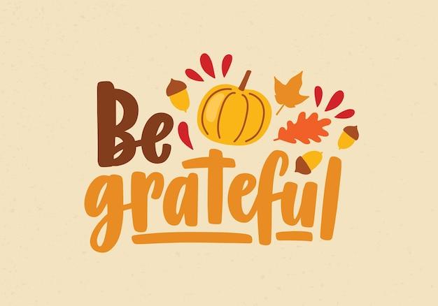 Wees een dankbare zin of bericht met de hand geschreven met kalligrafisch schrift en versierd met squash