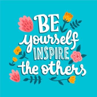 Wees jezelf inspireer de anderen belettering met bloemen
