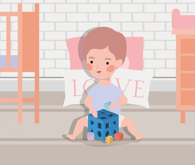 Weinig babyjongen met blokkenstuk speelgoed