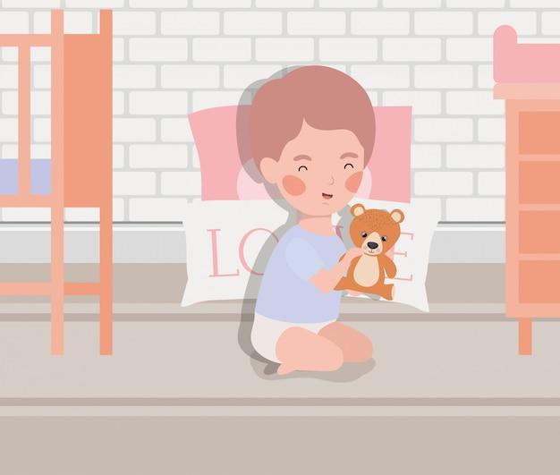 Weinig babyjongen met teddy beer
