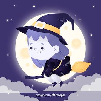 Weinig heksenmeisje dat op haar bezem vliegt