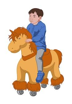 Weinig jongen die een stuk speelgoed pony berijdt