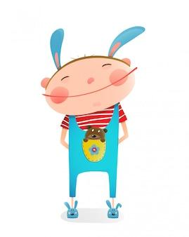 Weinig jongen met het grappige leuke stuk speelgoed van de beerwelp in zak