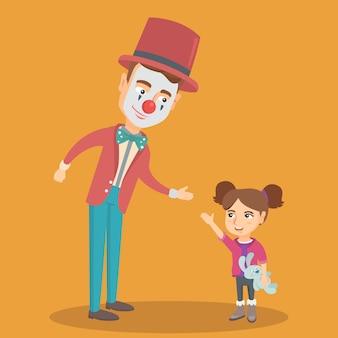 Weinig kaukasisch meisje dat met clown speelt.