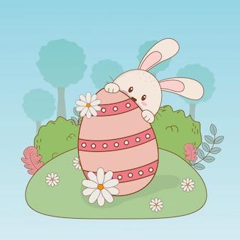 Weinig konijn met ei geschilderd pasen-karakter