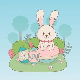 Weinig konijn met eieren geschilderd pasen-karakter