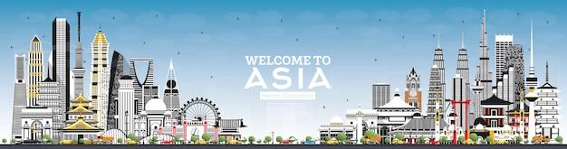 Welkom bij de skyline van azië met grijze gebouwen en blauwe lucht. tokio. sjanghai. singapore. delhi. riyad.