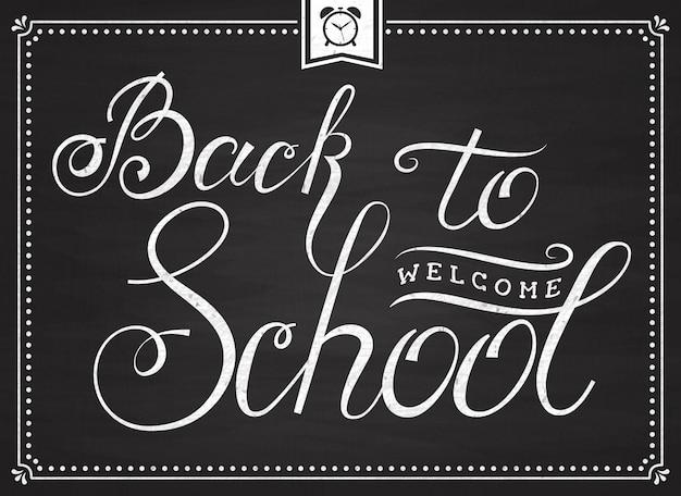 Welkom terug op school! banner met handschrift op schoolbord