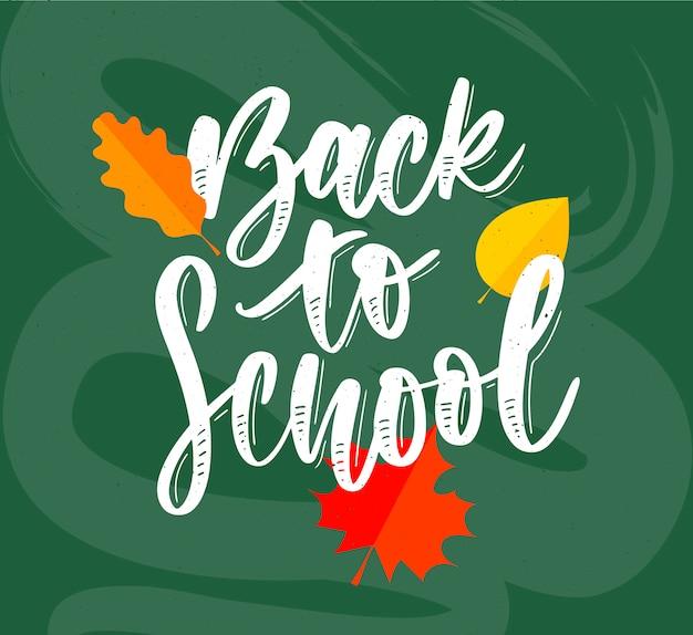 Welkom terug op school, belettering met witte letters en kleurrijke bladeren