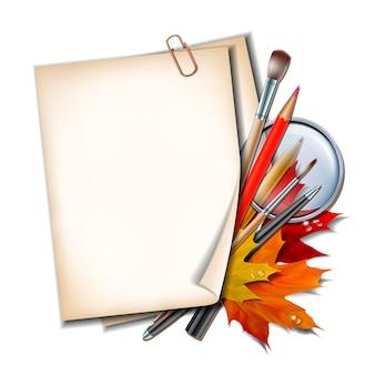 Welkom terug op school. schoolitems en -elementen. papieren vel met herfstbladeren, pennen, potloden, borstels en vergrootglas.