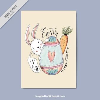 Wenskaart met konijn en easter egg
