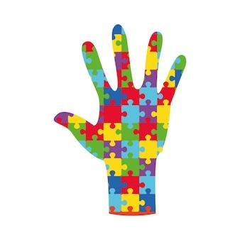 Wereld autism awareness day banner met hand samengesteld uit puzzelstukjes legpuzzel veelkleurig
