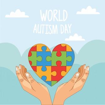 Wereld autisme dag met handen en puzzel hart