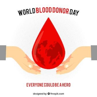 Wereld bloeddonor dag achtergrond met grote druppel bloed in het midden