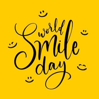 Wereld glimlach dag belettering met blije gezichten Gratis Vector