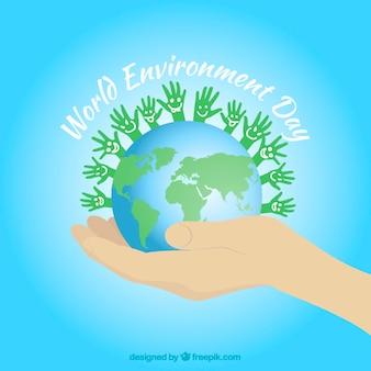 Wereld met groene handen achtergrond