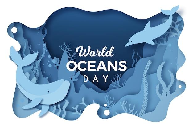 Wereld oceanen dag in papier stijl met dolfijnen en walvissen