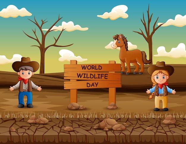 Wereld wildlife day-bord met cowboy en veedrijfster in het droge