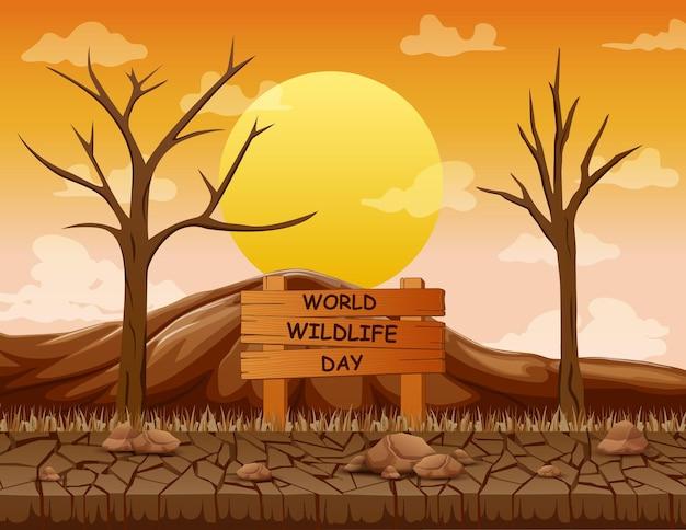 Wereld wildlife day-bord met dode bomen en in de gebarsten grond