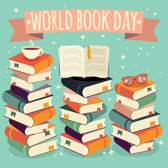 Werelddagboek, open boek op stapel boeken met een bril op munt achtergrond