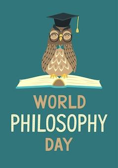 Wereldfilosofie dag wijze uil zittend op een open boek