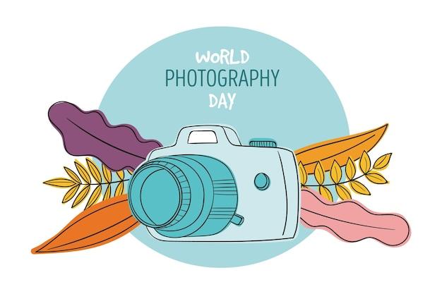 Wereldfotografie dag met camera en bladeren