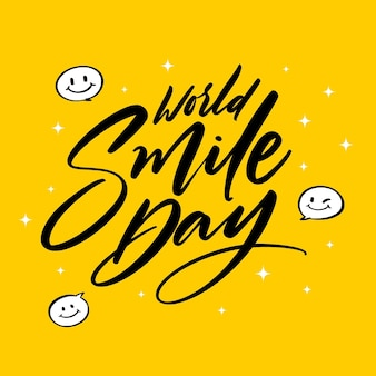 Wereldglimlachdag met blij gezicht belettering
