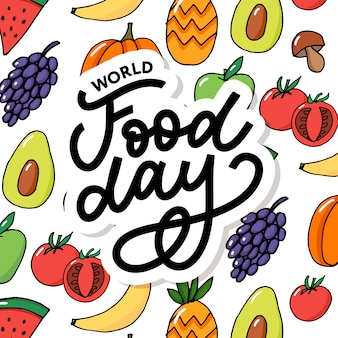 Wereldvoedseldag belettering met kleurrijke groenten en fruit