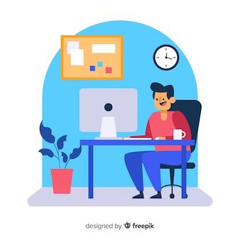 Werkende persoon zit aan bureau