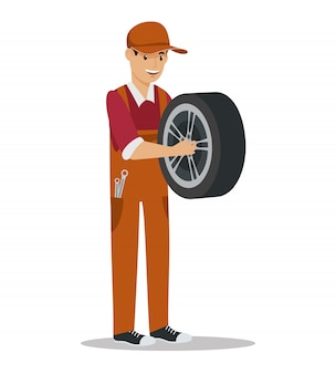 Werknemer met wiel in de hand. servicestation. auto service. auto onderdelen. wielreparatie. professionele werknemer in uniform. auto onderhoud.