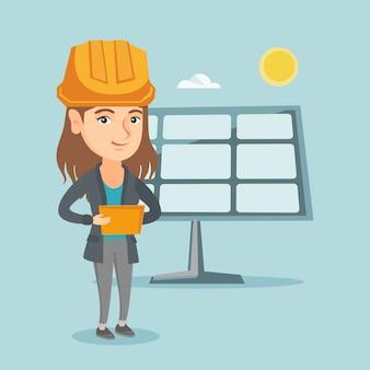 Werknemer van zonne-energiecentrale met behulp van een digitale tablet