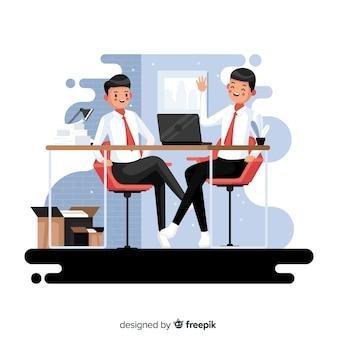 Werknemers zitten aan een bureau op hun werk