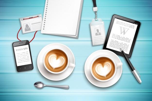 Werkplek bovenaanzicht met cappuccinokentekens en gadgets op geweven blauwe realistische illustratie