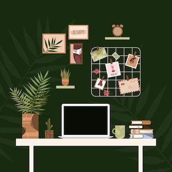 Werkplek thuis. kantoor aan huis interieur. werkruimte thuis tafel, laptop, schilderijen, fotobord.
