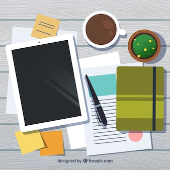 Werkruimte met tablet en notitieboekje