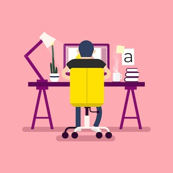 Werkruimte voor grafisch ontwerpen. ontwerpers zittend op het bureau, achteraanzicht.