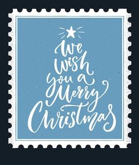 Wij wensen u een vrolijk kerstfeest belettering. kalligrafie tekst op blauwe vintage stempel achtergrond, winter vakantie wenskaart.